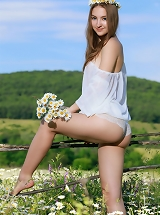 Beautiful Izabel A poses like a fairy in the flowery fields as she flashes her delighting body.