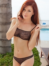 Mia Sollis strips her erotic black bikin as she flashes her incredible figure and scrumptious breasts by the pool.