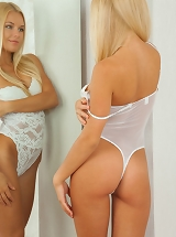 adorable blonde Xena clothing her white lace teddy underwear that demonstrates off her elegant curves