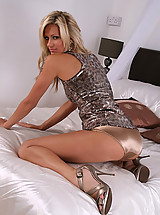 Blonde Sandra wearing a small satin skirt